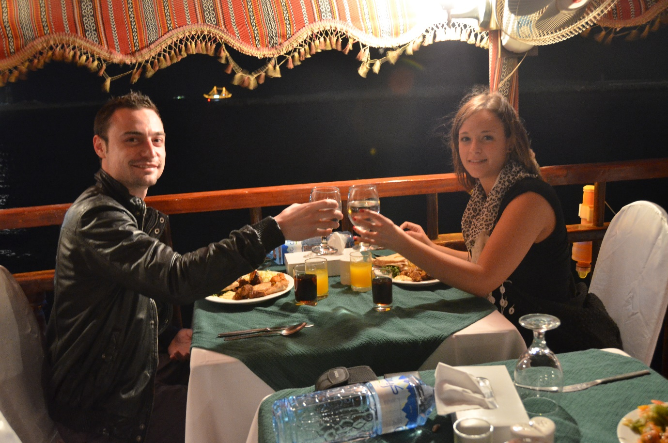 Couples having dinner in dhow cruise creek