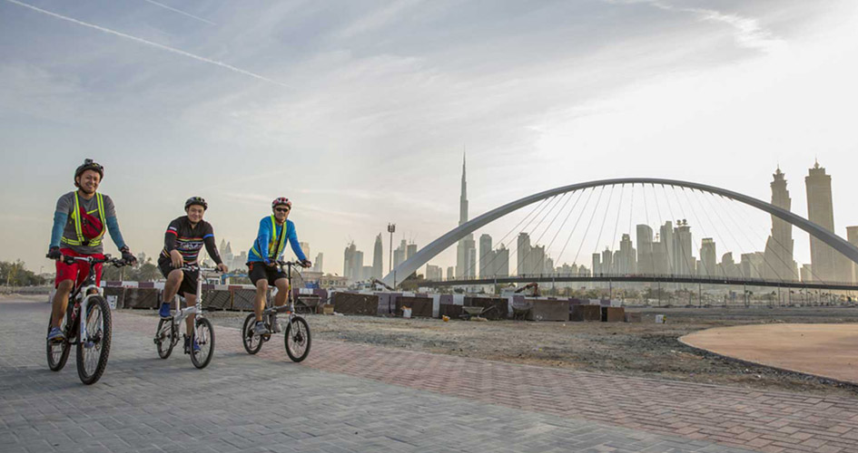 Cyclists in Dubai Water Canal